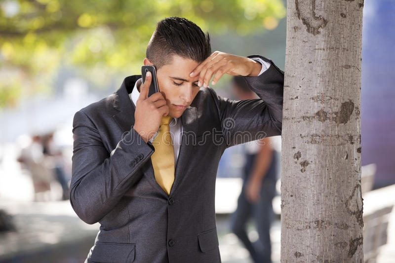 Businessman talking at his cellphone stock images