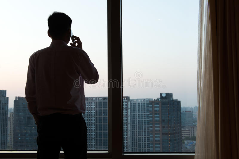 Businessman talking on the mobile phone stock images