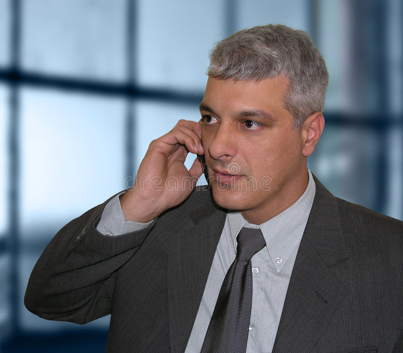 Businessman talking on the phone. Business man talking on a cell phone stock images