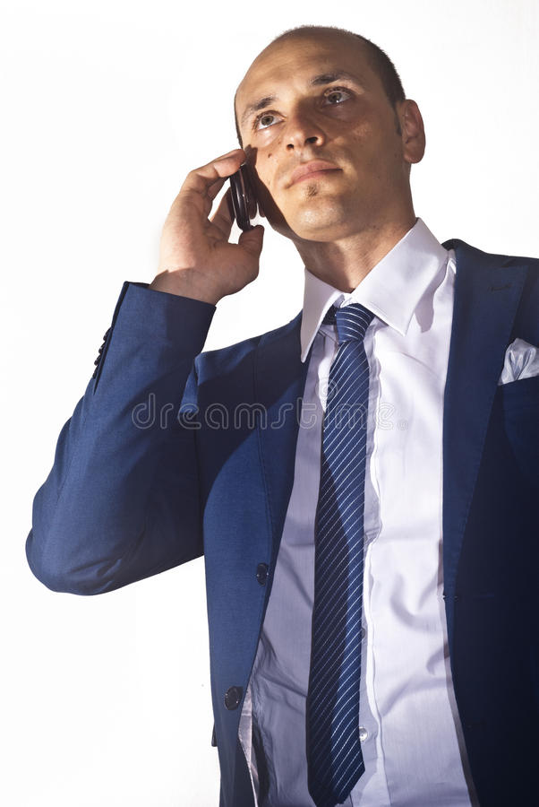 Businessman talking on the phone. Elegant businessman wearing suit talking on the phone royalty free stock photography