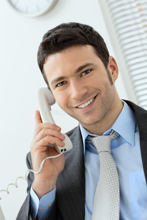 Businessman talking on phone stock photography