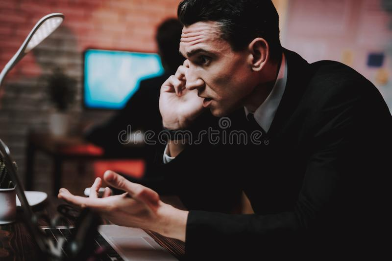 Businessman Talking on Phone on New Year Eve. royalty free stock photos