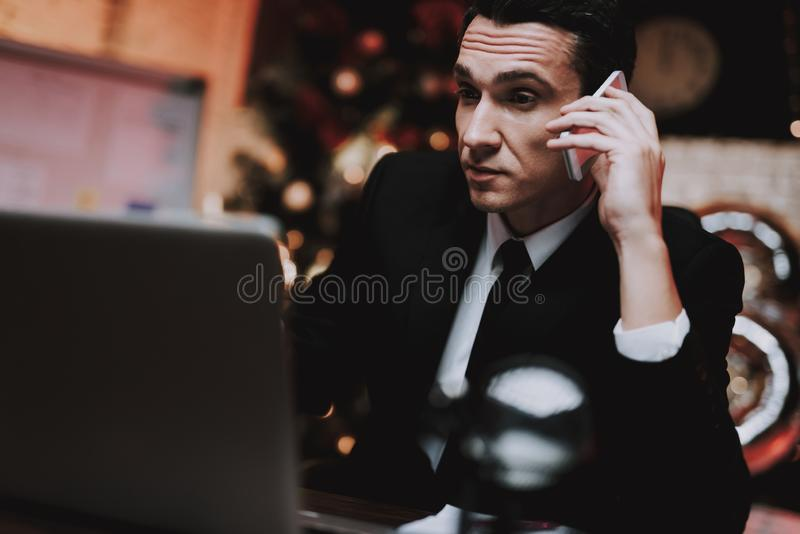 Businessman Talking on Phone on New Year Eve. stock photos