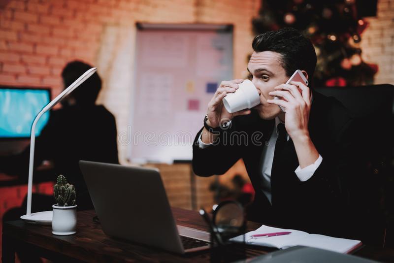 Businessman Talking on Phone on New Year Eve. stock images