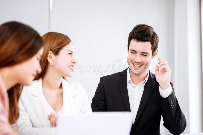 Businessman talking and smiling.Young team of coworkers making great business discussion in modern office.Teamwork people concept. royalty free stock photography