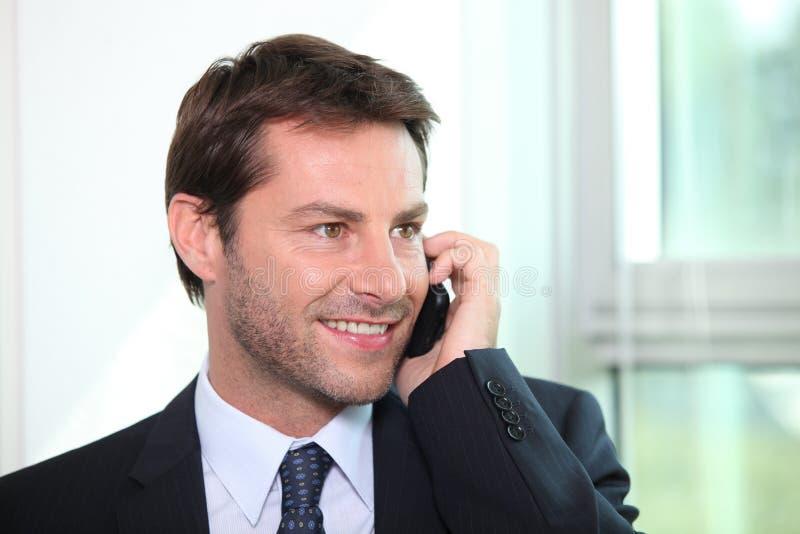 Businessman talking on a telephone royalty free stock photos