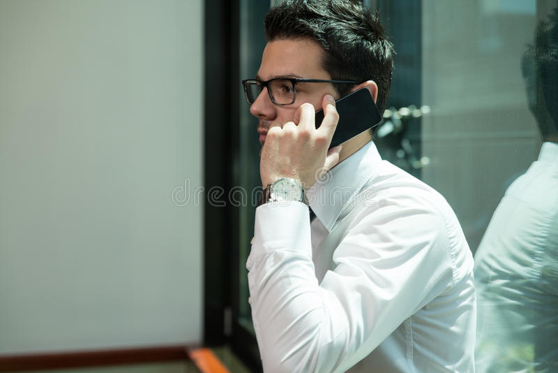 Download Businessman Talking On Telephone In Office Stock Photo - Image of confident, close: 43253232