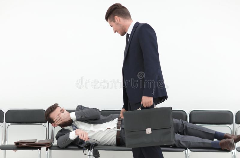 Businessman talking to a tired visitor royalty free stock image