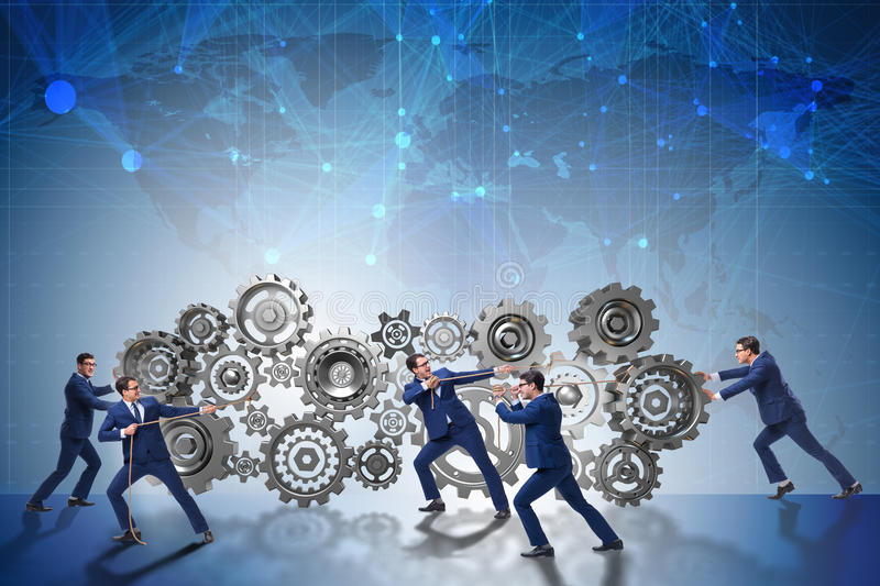 The businessman in teamwork concept with cogwheels. Businessman in teamwork concept with cogwheels stock photos