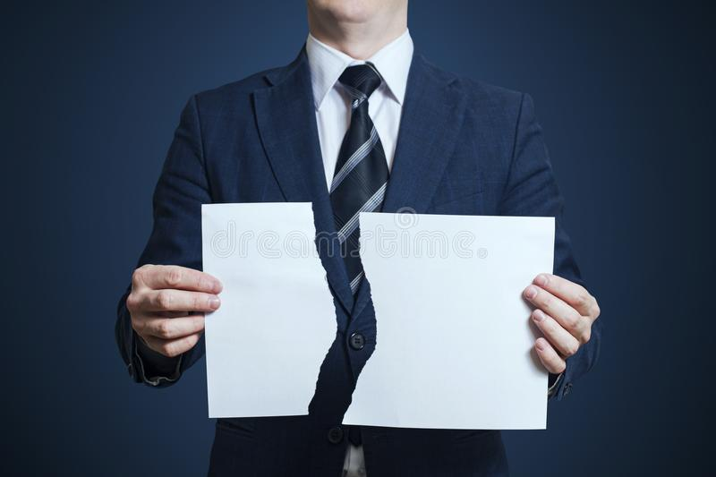 Businessman tearing blank paper apart royalty free stock photography