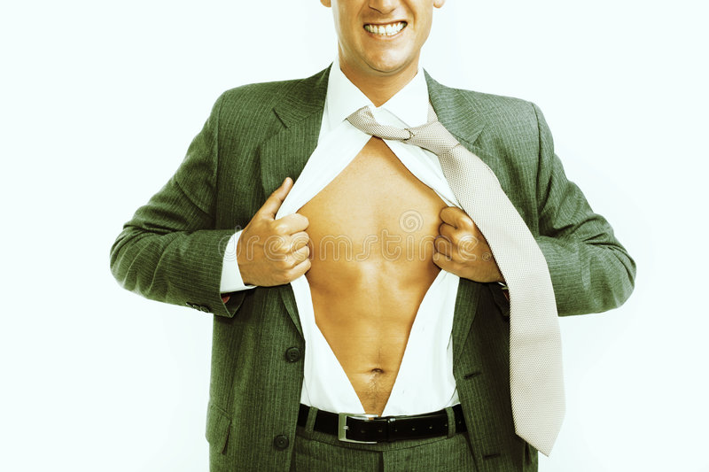 Businessman tearing his shirt open. Cross-processed image of a businessman tearing his shirt open royalty free stock images