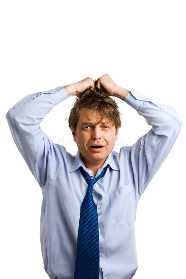 Businessman tears his hair stock photo