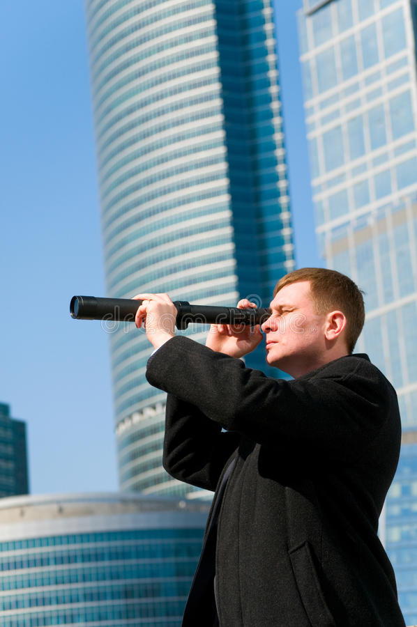 Businessman with telescope royalty free stock photography