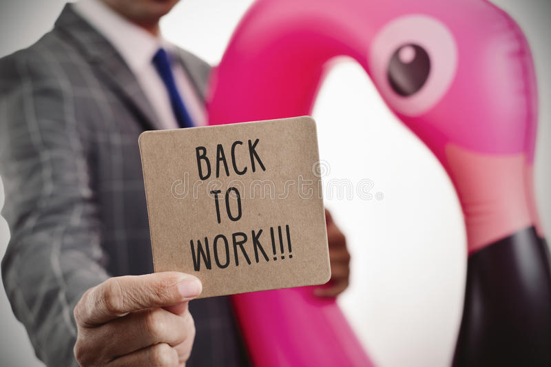 Businessman and text back to work in a signboard royalty free stock photos