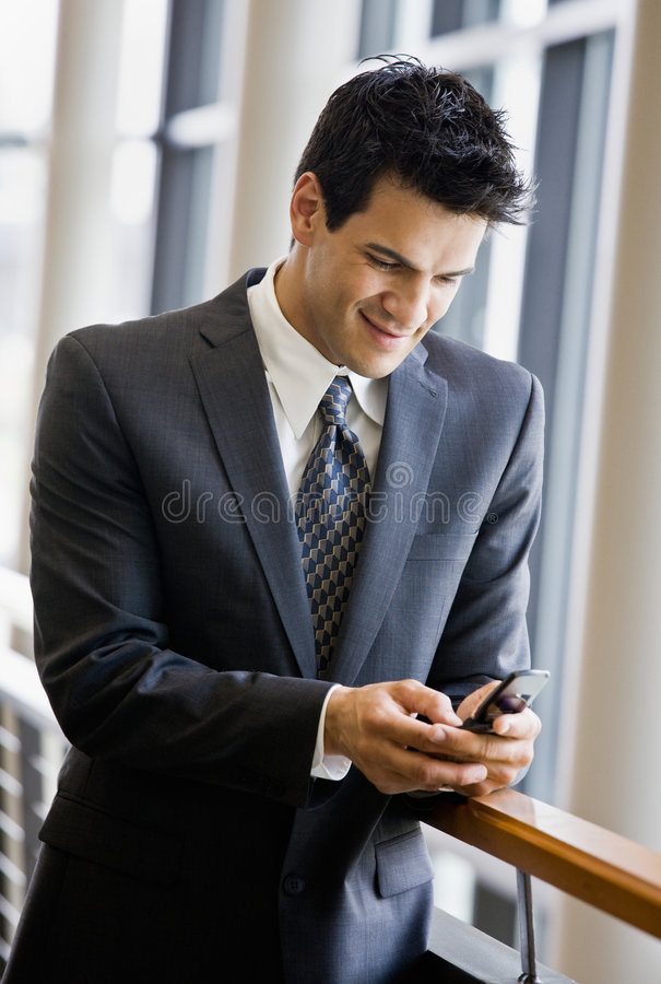 Download Businessman Text Messaging On Cell Phone Stock Image - Image: 6604235