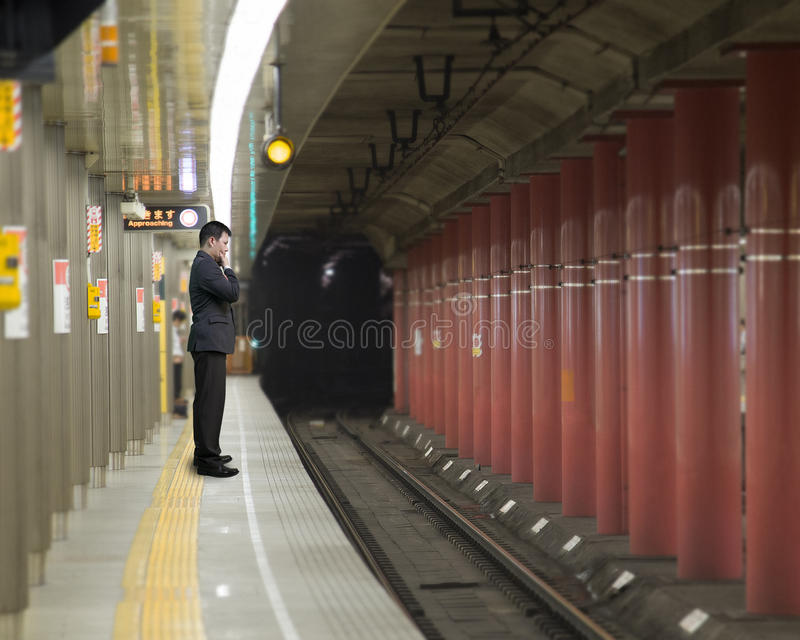 Businessman thinking and standing on the platform stock images