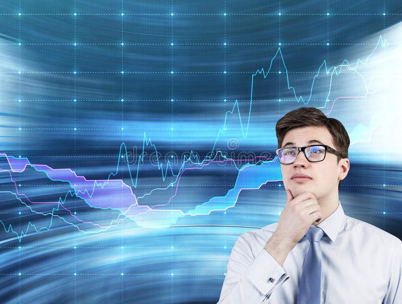 Businessman thinking. And stock chart on virtual screen stock image