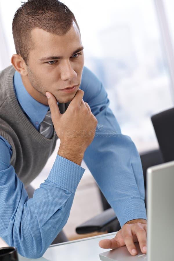 Businessman thinking at work royalty free stock image