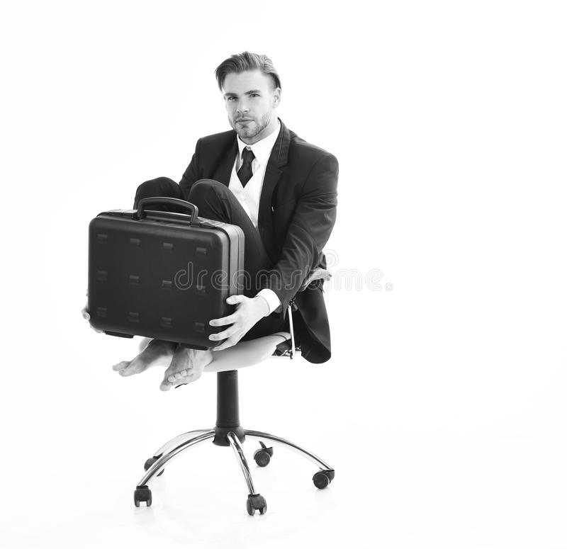Businessman thinks about credit debts on white background. stock photography