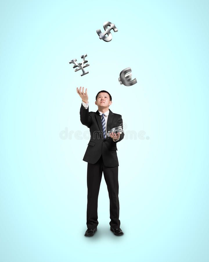 Businessman throwing and catching 3D money symbols stock images