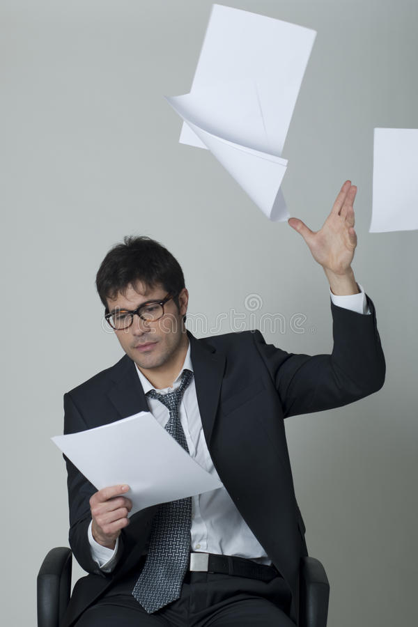 Download Businessman Throwing Documents Away! Royalty Free Stock Photography - Image: 14777567