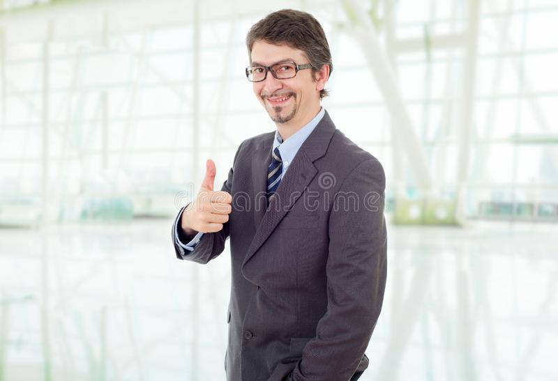 Businessman thumb up stock photo