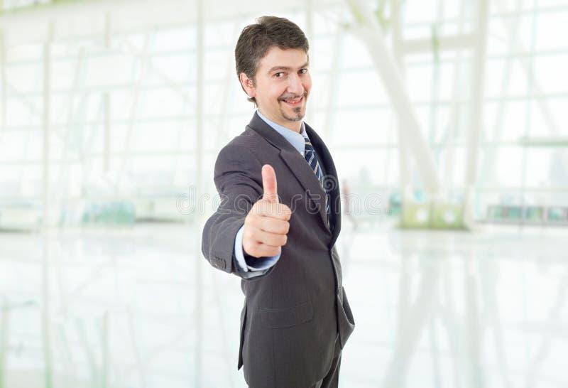 Businessman thumb up stock photos