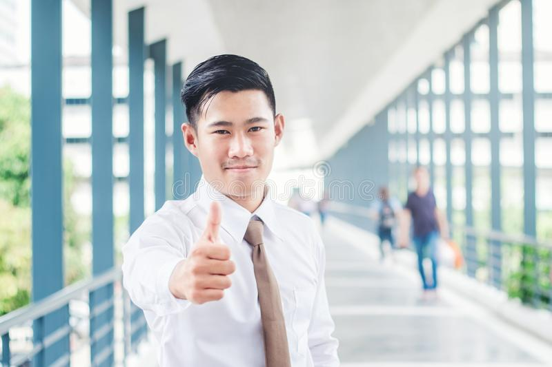 Businessman Thumbs up and expressing positivity celebrating success concept while standing outdoors royalty free stock images