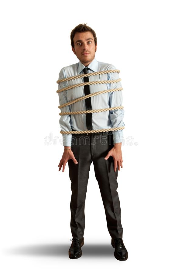 Businessman tied up with rope. On white background royalty free stock photography