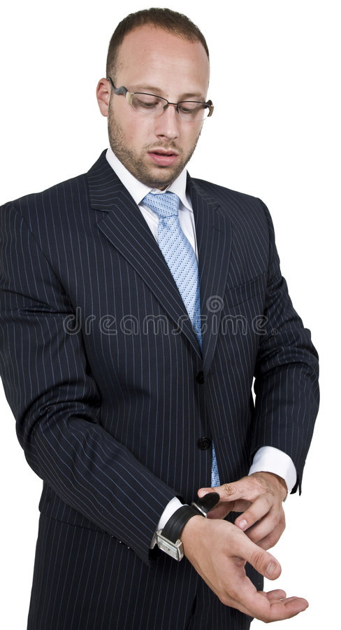 Businessman tighting the watch royalty free stock images