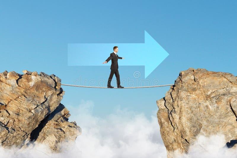 Businessman on tightrope goal concept stock photos