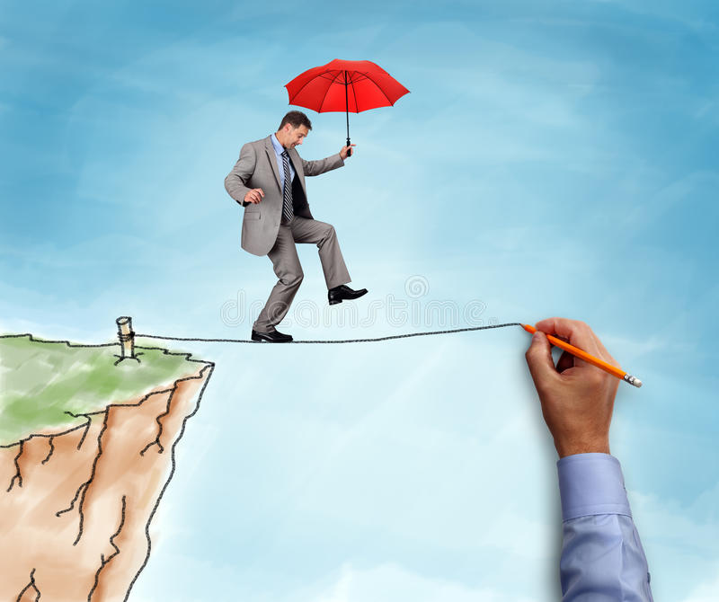 Businessman on a tightrope. Businessman on a hand drawn tightrope and cliff holding red umbrella concept for business risk, challenge and assistance royalty free stock image
