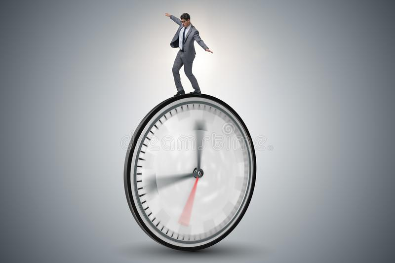 The businessman in time management concept. Businessman in time management concept stock images