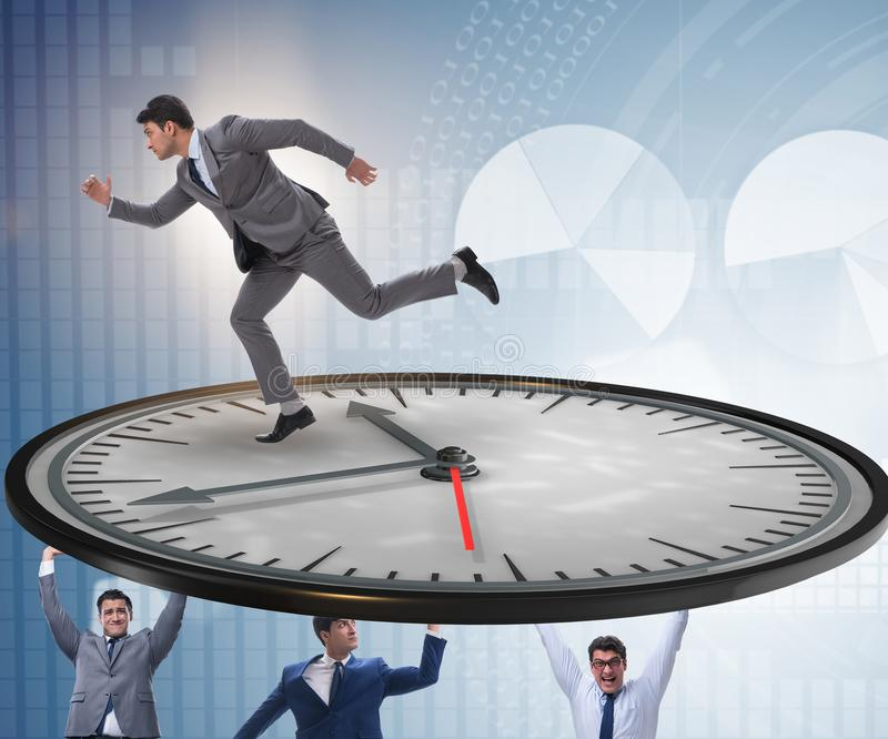 Businessman in time management concept. The businessman in time management concept stock photography