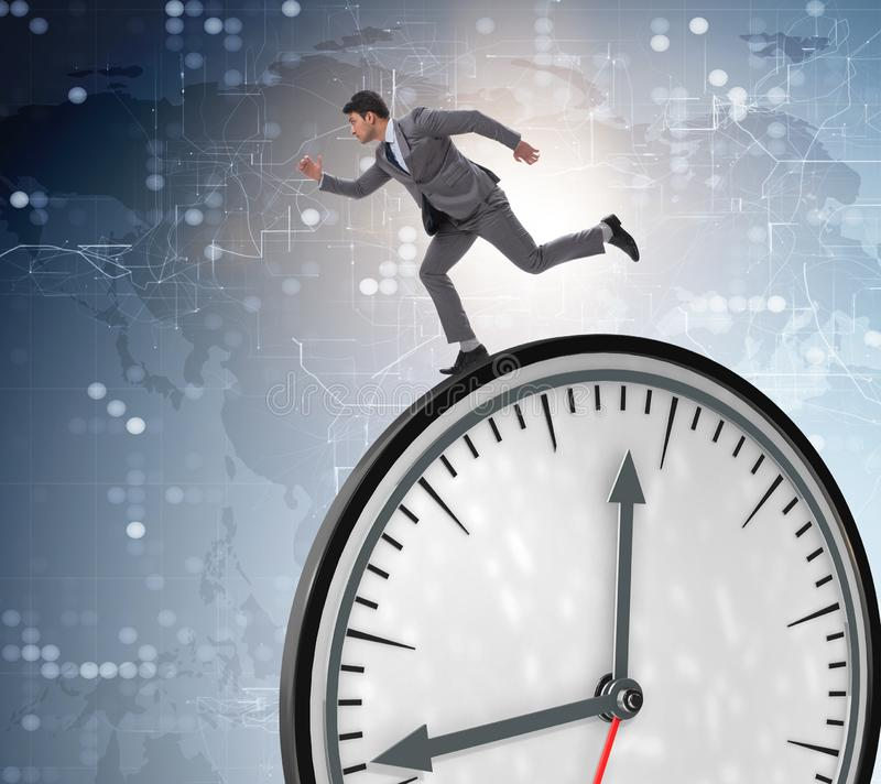 Businessman in time management concept. The businessman in time management concept stock photos