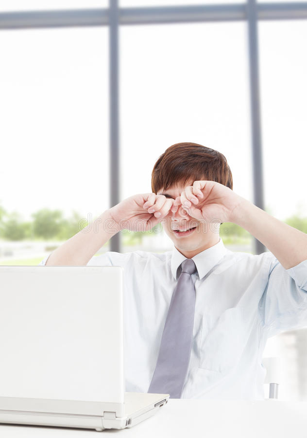 Businessman with tired eyes royalty free stock photos