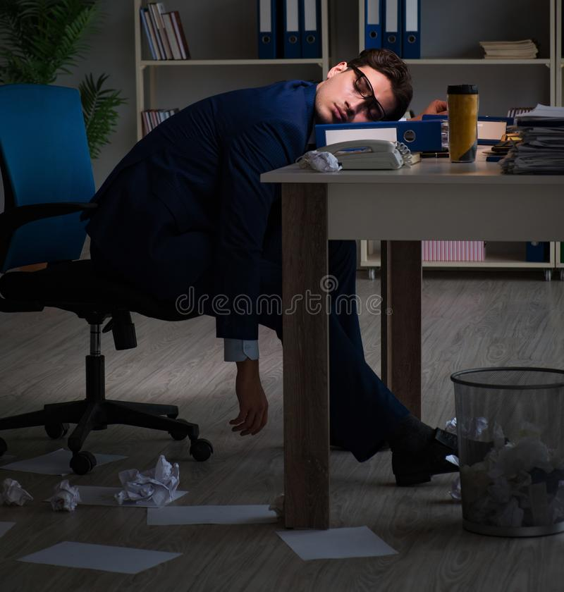 The businessman tired and sleeping in the office after overtime. Businessman tired and sleeping in the office after overtime hours royalty free stock photo