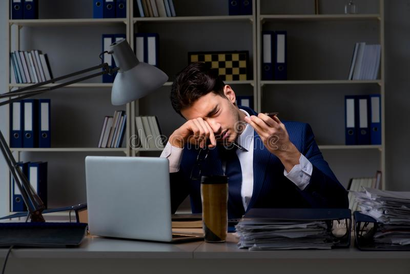 Businessman tired and sleeping in the office after overtime hour. S stock images