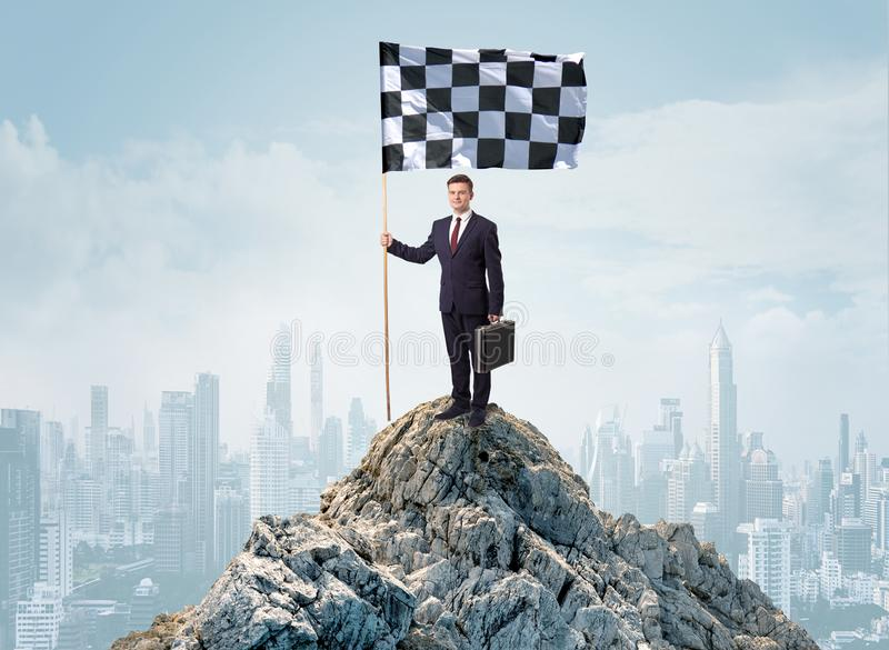Businessman on the top of a city achieving his goal royalty free stock image