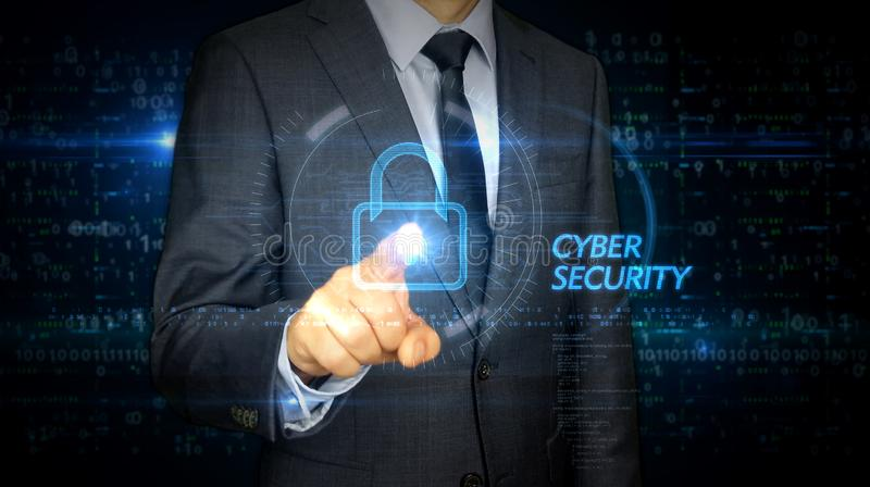 Businessman touch screen with cyber security hologram royalty free stock photo