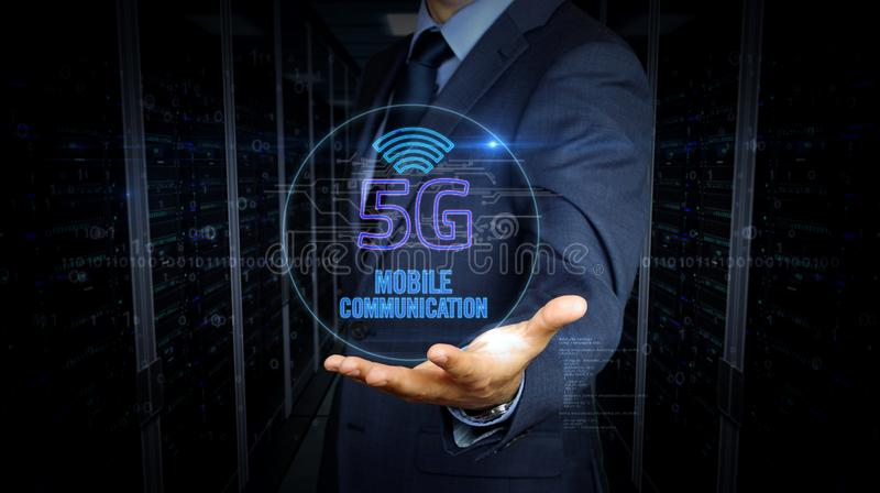 Businessman touch screen with 5G symbol hologram royalty free stock image