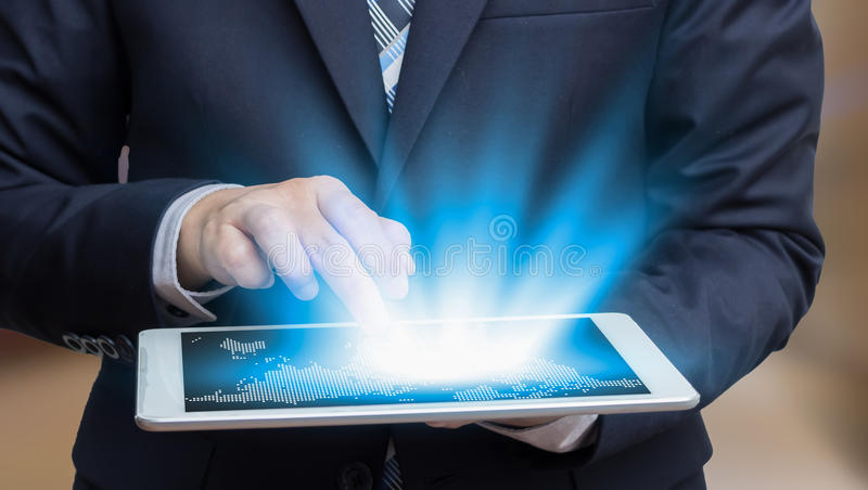 Businessman touch on screen tablet technology concept and ecommerce stock photos