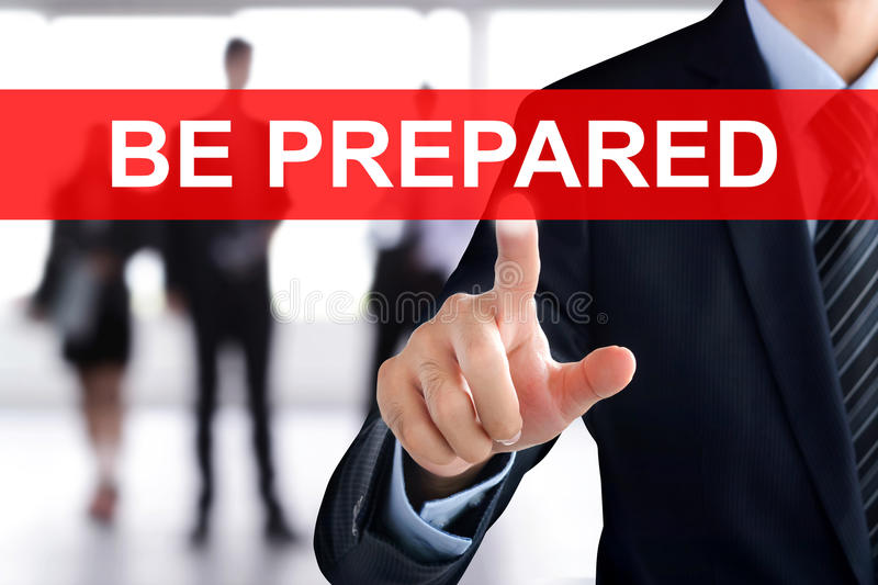 Businessman touching BE PREPARED tab on virtual screen royalty free stock photography