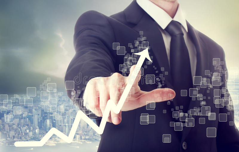 Businessman Touching a Chart Indicating Growth royalty free stock photo