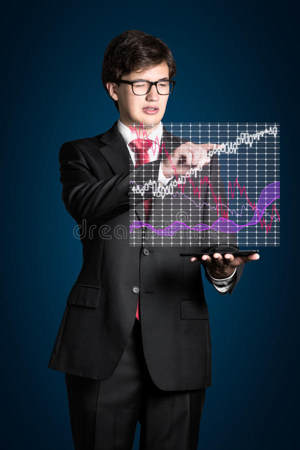 Businessman touching chart. Businessman touching stock chart on virtual screen royalty free stock images