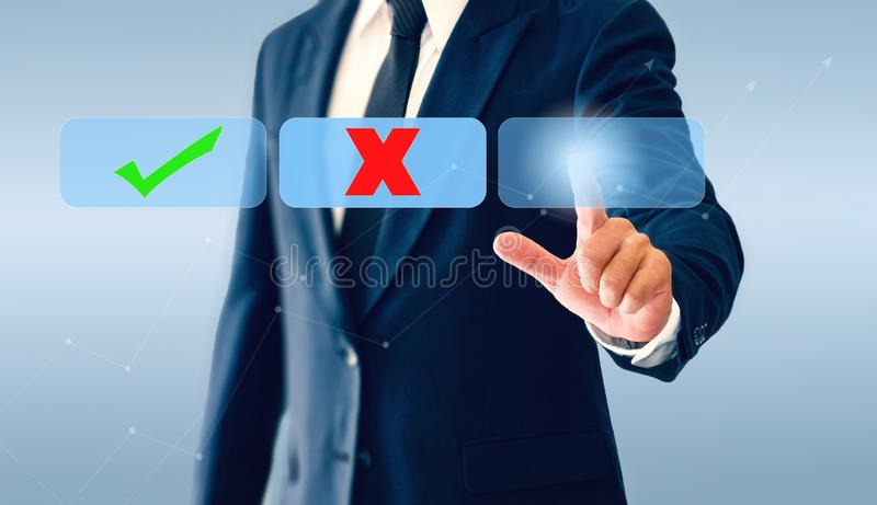 Businessman touching check marks virtual button. Concept of business decision may be right or wrong stock photography