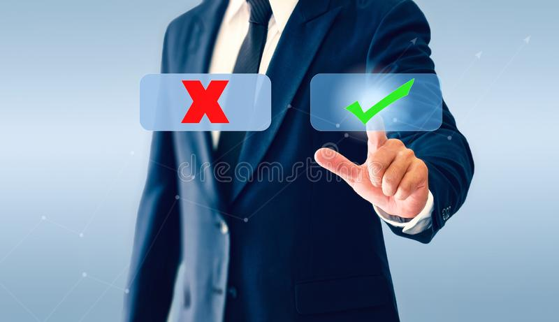 Businessman touching check marks virtual button. Symbol mark and wrong. Businessman ing check marks virtual button. Symbol mark and wrong royalty free stock images
