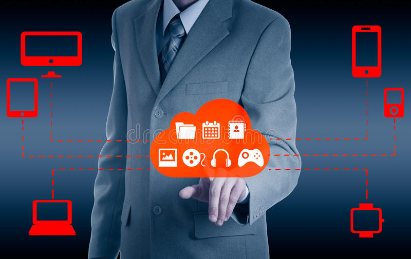 Businessman touching a cloud connected to many objects on a virtual screen, concept about internet of things.  stock image