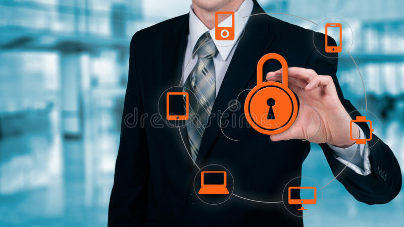 Businessman touching a cloud connected to many objects on a virtual screen, concept about internet of things.  royalty free stock photo