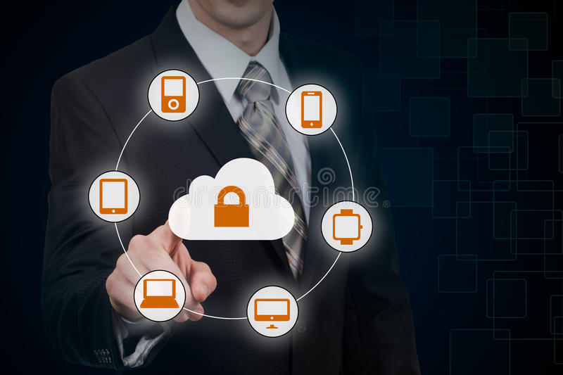 Businessman touching a cloud connected to many objects on a virtual screen, concept about internet of things.  royalty free stock photography